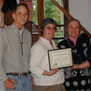 President Linda Campbell (center) with Ken and Marnie Crowell